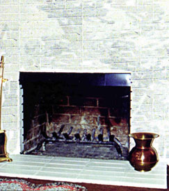 A smoke guard on a fireplace to prevent smoking problems