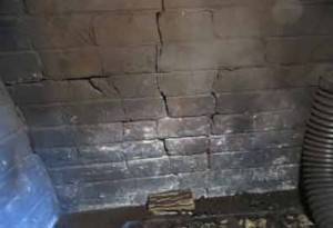 Cracked backwall of fireplace