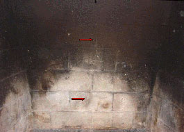 A firebox in need of a masonry firebox repair