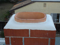 Masonry chimney with a clay lining