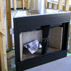 A brand new prefab fireplace system during the installtion process