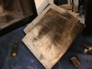 Burned out and cracked refractory panels for a prefab fireplace